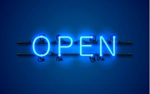 "neon blue ""open"" sign"
