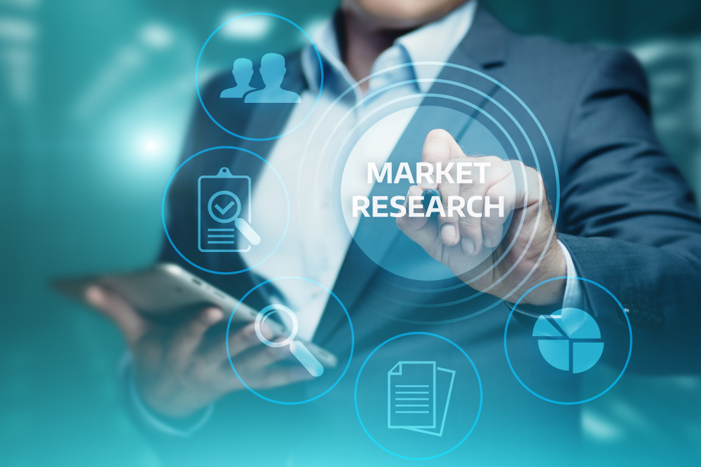 Man holding mobile device with translucent market research icon in front